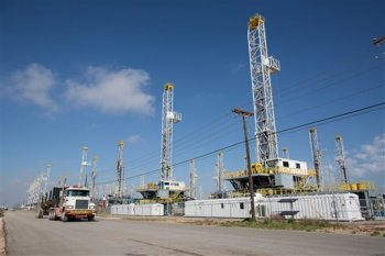 Over thirty oil drilling rigs idling in a Helmerich & Payne, Inc. yard along Groening Street in Odessa, Texas, in the Permian Basin on May 18, 2015. (Courtney Sacco/Odessa American via AP)