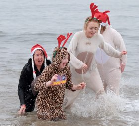 Squealing: The dip in Redcar, North Yorkshire, is held annually to raise hundreds of pounds for a range of local and national charities