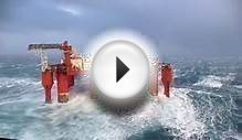 Huge waves crash against swaying North Sea oil rig - BBC