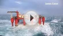 Scotland storm: Giant waves crash into a swaying oil rig