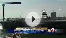 Tugboat, barge take out floating pier in Port Canaveral